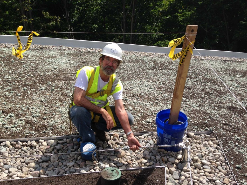 Charlie Miller, Roofmeadow Founder and President, on site during the first ever installation of Diadem's Dynamic Fall Arrest System